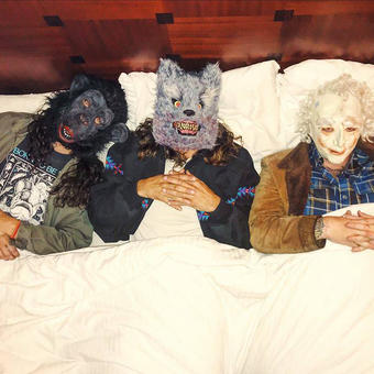 Three men in animal masks